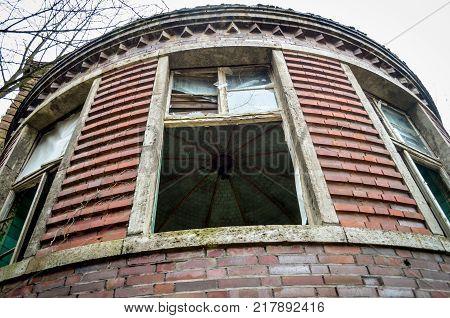 brokwn window of a lost hospital in germany