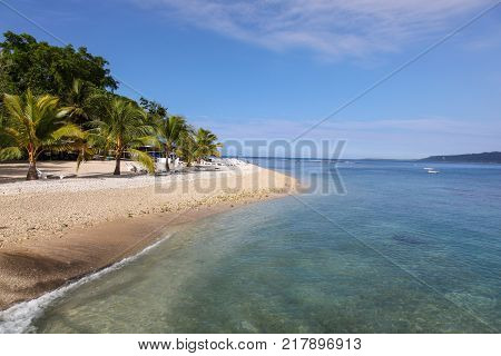 A beautiful sunny day in Vanuatu. There are many locations where you can relax on the shore and walk into the snorkle on coral reefs with tropical fish.