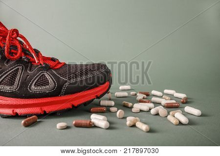 Red sports shoes come on formological pills. This is the concept of healthy sport and lifestyle vs doping scandal.
