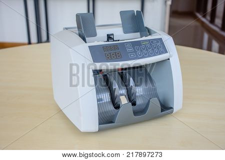 photo of cash counting machine on the table