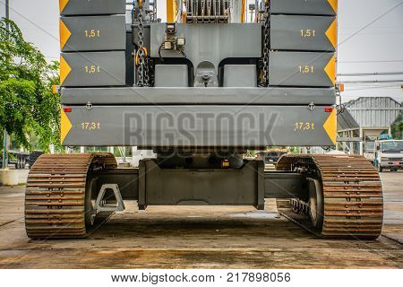 rear view of big crawler crane counterweights and big chain poster