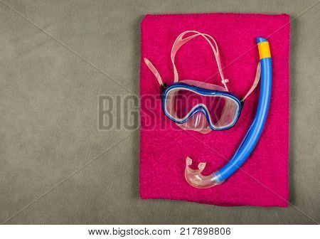 Typical snorkeling equipment - snorkel diving mask on the towel.