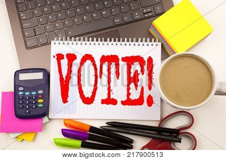 Word writing Vote in the office with  laptop, marker, pen, stationery, coffee. Business concept for Voting Electoral Vote Workshop white background with space