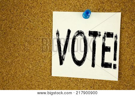 Conceptual hand writing text caption inspiration showing Vote. Business concept for  Voting Electoral Vote written on sticky note, reminder cork background with space