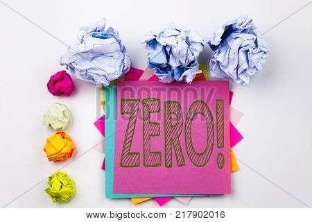 Writing text showing Zero written on sticky note in office with screw paper balls. Business concept for Zero Zeros Nought Tolerance on white isolated background.