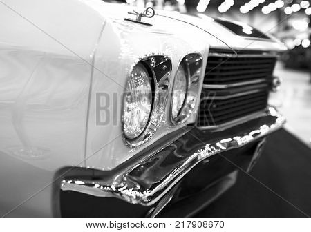 Sankt-Petersburg Russia July 21 2017: Front view of a great retro american muscle car Chevrolet Camaro SS. Car exterior details. Black and white. Photo Taken on Royal Auto Show July 21