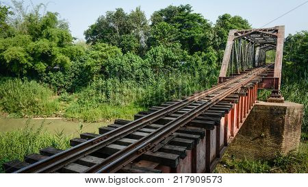 landscape photo of railway bridge in countryside of Myanmar, April-2017