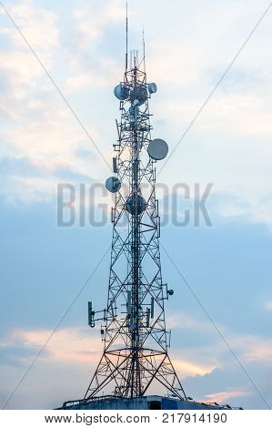 photo of mobile telecom tower with blue sky