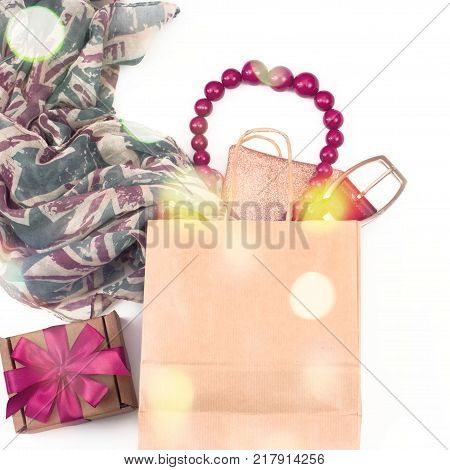 Decorative draping frame of the textile. Women's scarf pink figure the British flag. White background top view. Gift box with surprise. Square