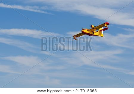 Radio controlled model hydroplane flying over blue sky
