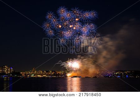 Celebration multicolored fireworks copy space. Canada Day holidays salute. New Year celebration colorful fireworks.