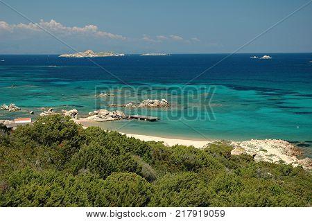 Pure clear azure sea water and amazing rocks on the coast of Maddalena island, Sardinia, Italy.