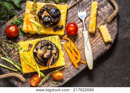 corn polenta with roasted mushrooms and eggplant traditional Italian food with vegetables and thyme