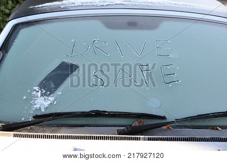 Drive safe message on a frozen windscreen