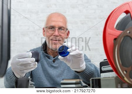 a technician digitalizing with white gloves negative film