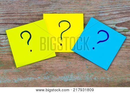 Questions, Decision Making Or Uncertainty Concept - A Pile Of Colorful Sticky Notes With Question Ma