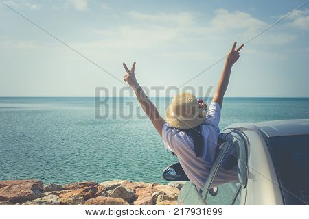 Vacation and Holiday Concept : Happy family car trip at the sea, Portrait woman feeling happiness in silver car.
