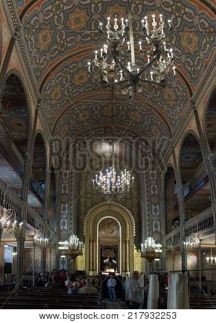 Bucharest Romania October 10 2017 : Tourists visiting and photographing the interior of the synagogue Coral in Bucharest city in Romania