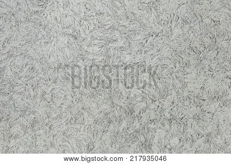 White fuzzy texture. Liquid wallpaper in home interior. Horizontal color photography.