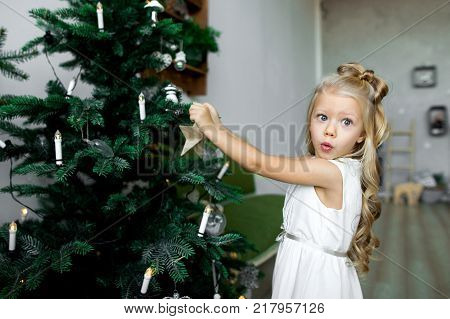 Christmas Table: Knife And Fork, Napkin And Christmas Tree Branch On A Wooden Table . New Year's Dec
