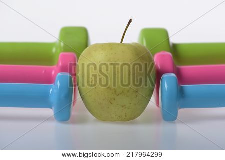 Apple Fruit Between Pink, Blue And Green Barbells In Pattern