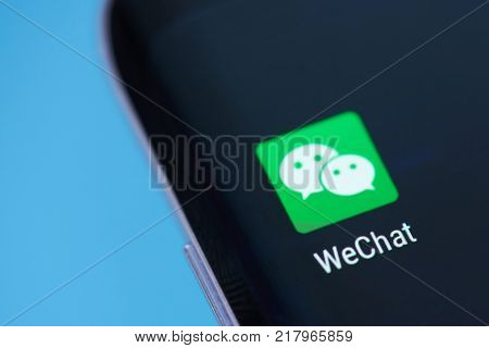 New york, USA - December 12, 2017: Wechat application icon on smartphone screen close-up. Wechat app icon with copy space on screen