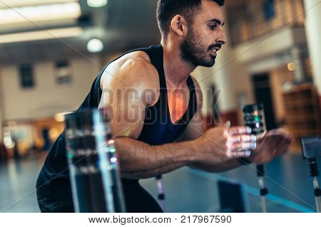 Male runner with mask running on treadmill machine testing his performance. Athlete examining his fitness in biomechanics lab.