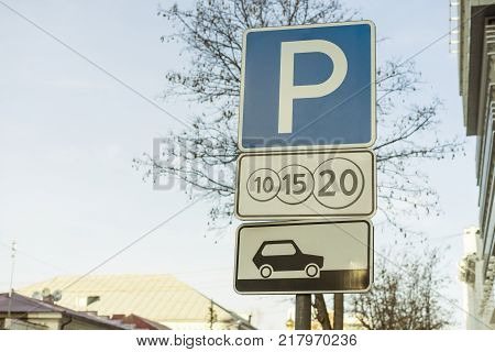 the blue Paid parking traffic sign in the city