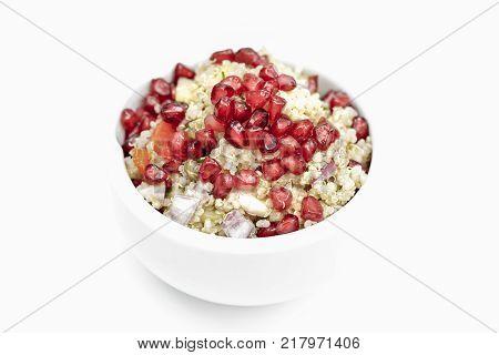 Quinoa salad with Pomegranate seeds, radicchio, cucumber and olives on white Background