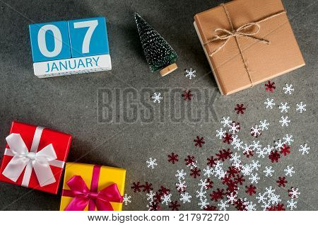 January 7th. Image 7 day of january month, calendar at christmas and happy new year background with gifts.