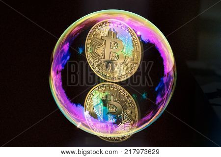 Bitcoin in a soap bubble. Suitable for speculative bubble or market bubble concept.