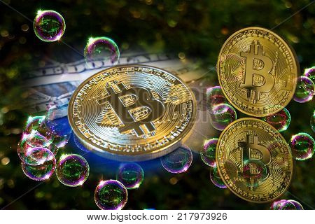 Bitcoin and a soap bubbles. Suitable for speculative bubble or market bubble concept.