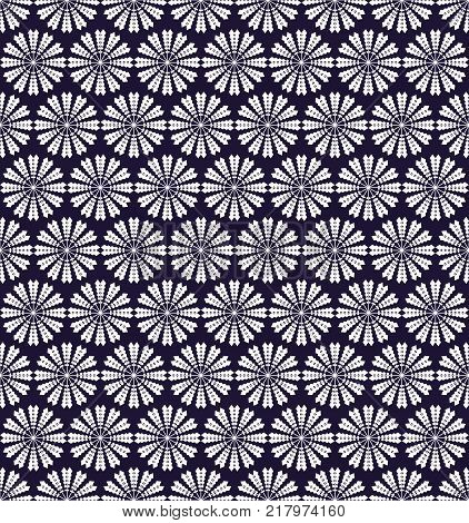 the white shapes (snowflakes) form a seamless pattern on an ultra-violet background