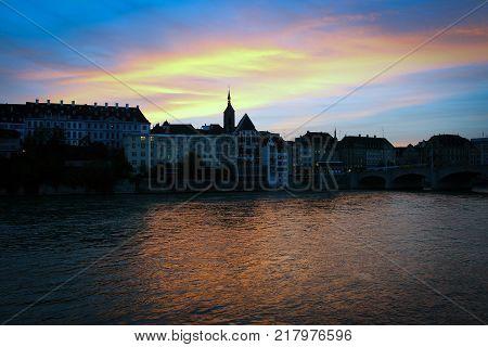 Rhein River embankment in Basel by sunset, Switzerland