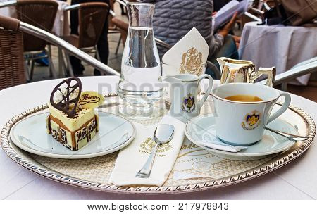 VENICE, ITALY - SEPTEMBER 28, 2014:  Dessert, cup of coffee and a carafe of water at Cafe Florian. It  is a coffee house situated in Piazza San Marco, Venice. It was established in 1720.