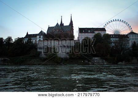 Rhein River embankmen scenic view by sunset, Basel, Switzerland