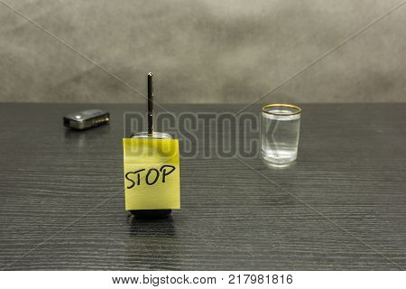 Stop on the car key. So we do not drive vehicles after alcohol - a glass of vodka.