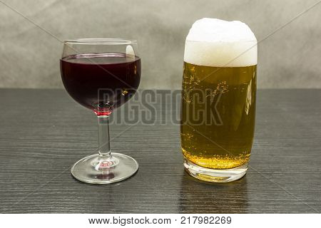 A glass of red wine or a pint of golden beer.