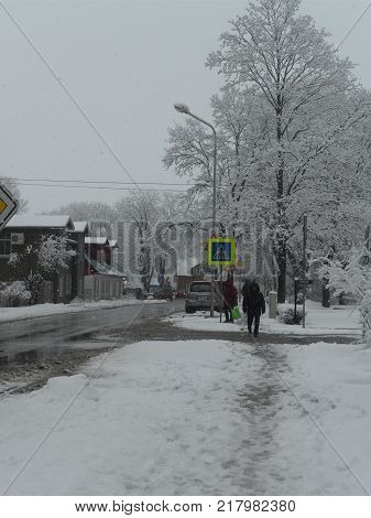 city in snow, winter has come.Snow-covered streets.