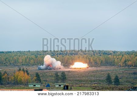 Nizhniy Tagil, Russia - September 25. 2013: Display of fighting opportunities of military equipment of land forces. Thermite bomb explosion released by Solncepek TOS-1A launcher. RAE-2013 exhibition