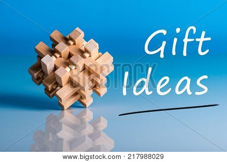 Gift ideas. Thinking about new year, Christmas, birthday and valentine day gifts and online shopping. Brain teaser symbolizing a difficult task and the choice of a present.