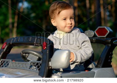 Baby in the toy car