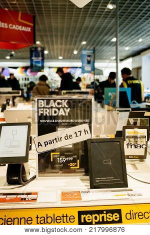 PARIS FRANCE - NOV 23 2017: Black Friday store shopping day in France Paris with customers people buying electronics gadget in Fnac retail chain - Kobo E-Reader for sale