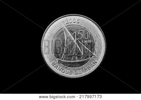 A super macro image of a Lebanese 50 livres coin isolated on a black background poster