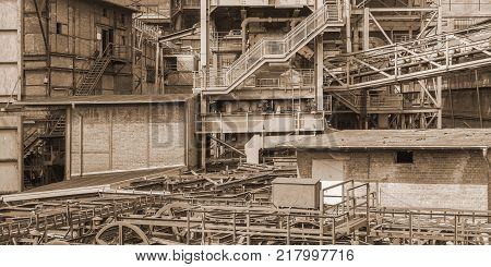 sepia toned weathered rusty industrial scenery with old corroded steel girders and metal tubes