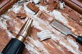 removing paint from the floor with a hot air gun repair tools chisel debris poster
