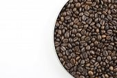 Coffee beans in pan on white background poster