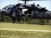 A US Air Force MH-60 Pavehawk Rescue Helicopter takes off from a landing zone at the Air Force Academy in Colorado Springs. poster
