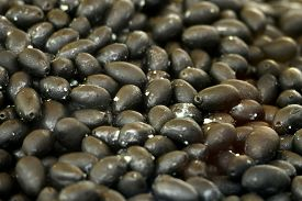 Background with stack of italian black olives