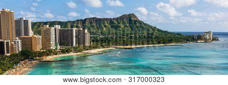 Hawaii panoramic Honolulu city travel landscape banner background of Waikiki beach and Diamond Head mountain peak at sunset, Oahu island, USA vacation.
